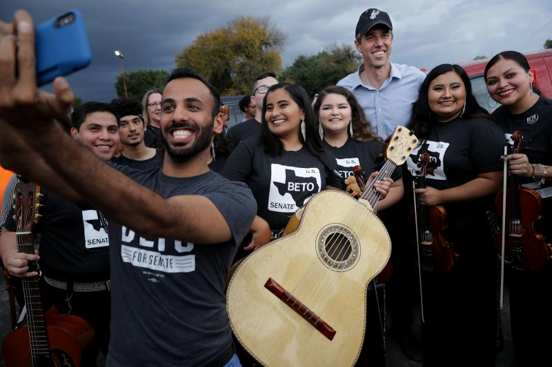 Then-U.S. Senate candidate Rep. Beto O'Rourke (D-Texas) poses with members of a mariachi band during an October 2018 campaign rally in San Antonio, Texas. O'Rourke is one of a score of Democratic politicians talking more explicitly about issues of race th