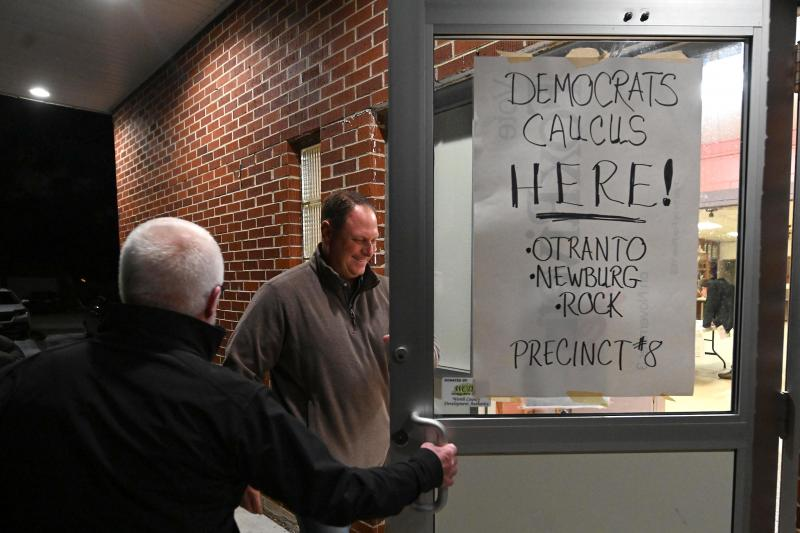 Voters head into their Iowa Democratic caucus site last year. Problems with a new smartphone app delayed reporting of the results for days or, for The Associated Press, permanently.