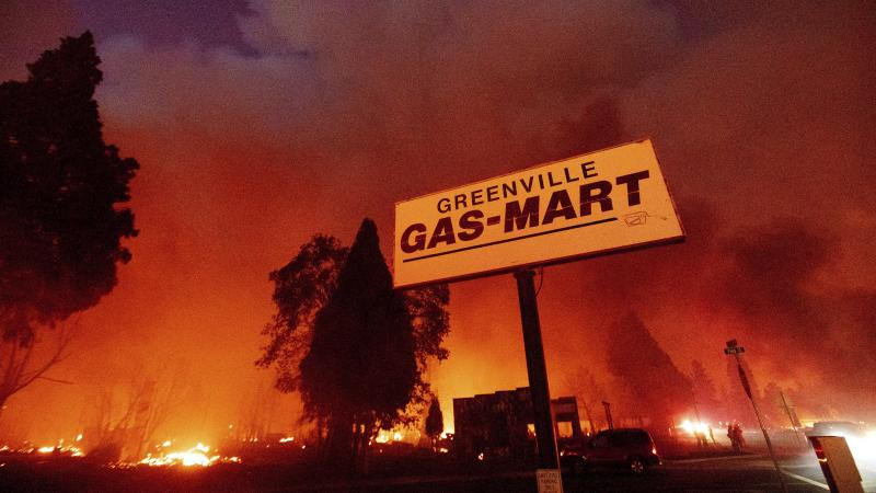 Flames consume buildings as the Dixie Fire tears through the Greenville community of Plumas County, Calif., on Aug. 4, 2021.