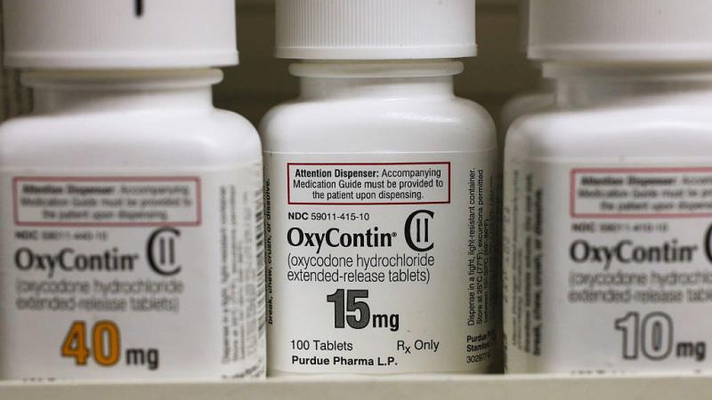 Bottles of Purdue Pharma L.P. OxyContin medication sit on a pharmacy shelf in Provo, Utah, in 2016.