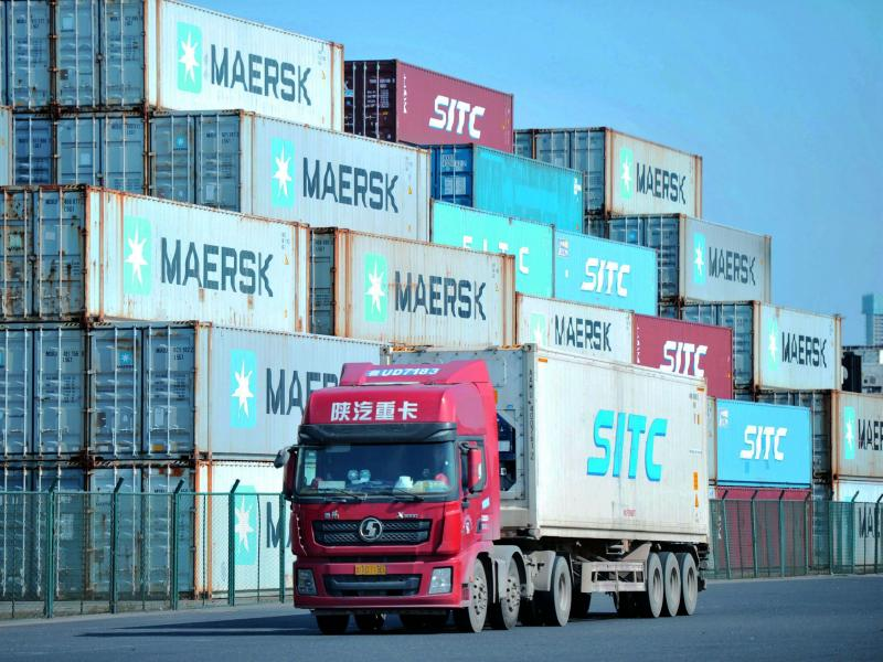 Containers are stacked at the port in Qingdao, in China's eastern Shandong province. A new trade deal dictates that China buy more from the U.S.,  but that has other trading partners worried.