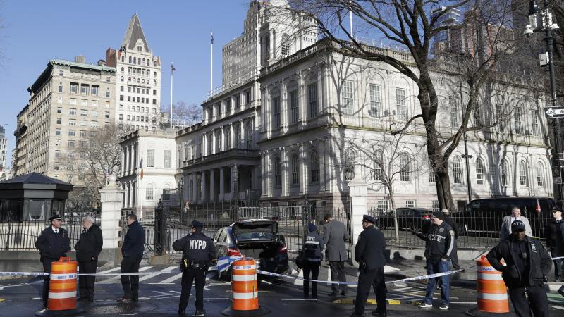 Police investigate a car stopped in front of a security gate this week outside City Hall in New York. Douglas Schifter, a longtime New York City livery driver, took his life in front of City Hall.
