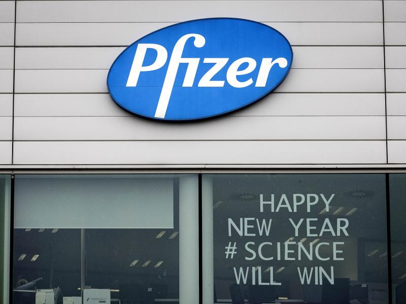 A sign appears in the window of an office at Pfizer Manufacturing in Puurs, Belgium, on Monday, the same day the European Medicines Agency authorized the use of the company's COVID-19 vaccine.