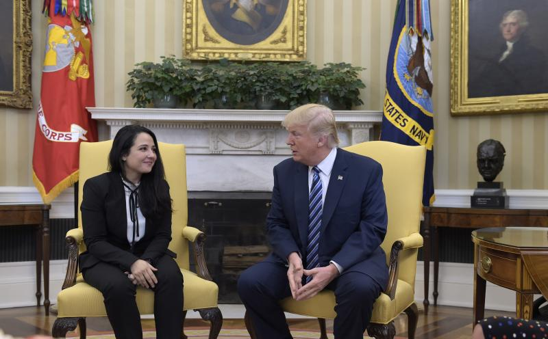 President Donald Trump meets with Aya Hijazi, an Egyptian-American aid worker, in the Oval office of the White House on Friday.