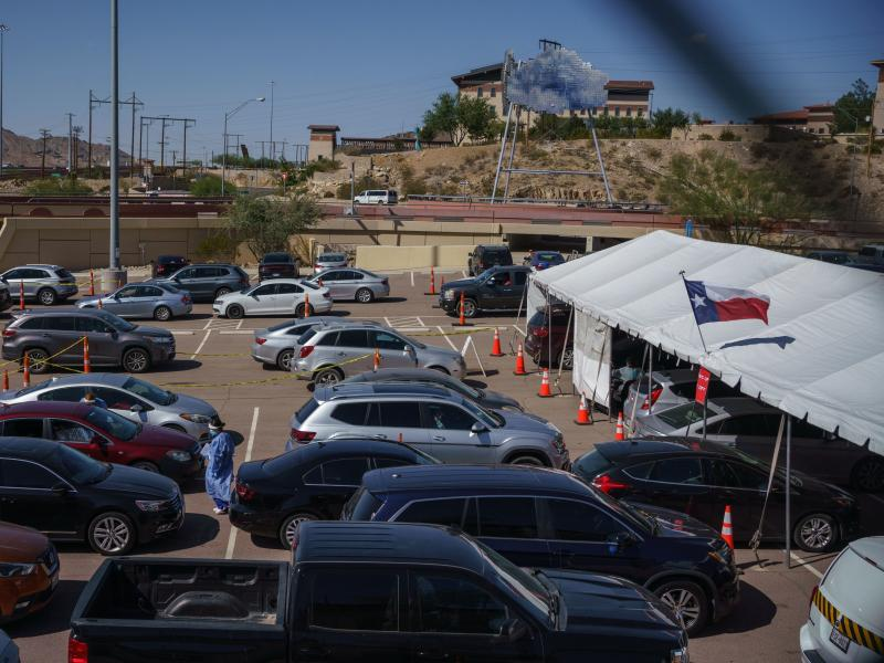 Cars line up for coronavirus tests at the University of Texas at El Paso on Oct. 23. The city has seen a surge in cases, prompting a judge to issue a shutdown of nonessential businesses.