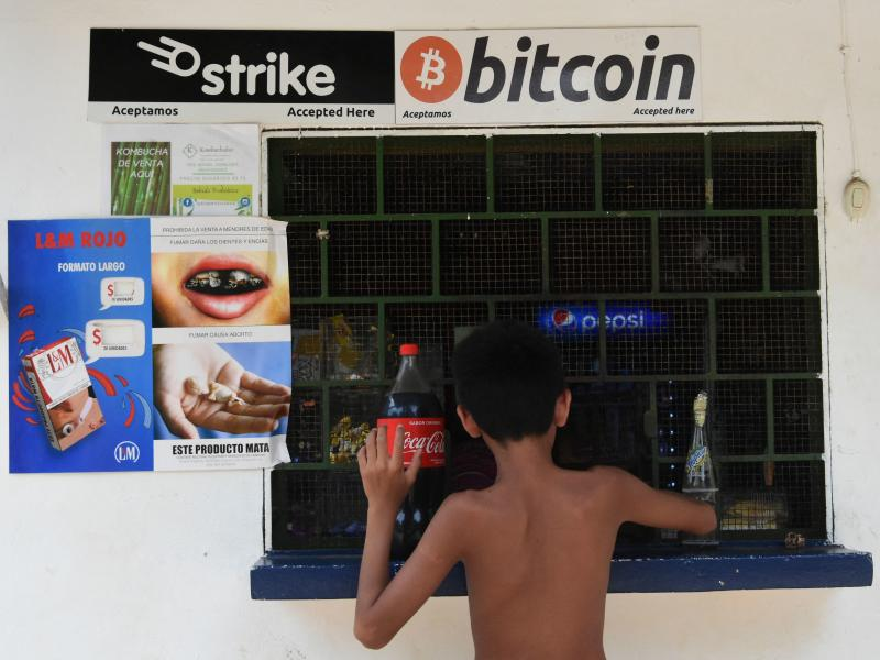 A sign at a store in El Zonte, El Salvador, advertises that it accepts bitcoins for payment.