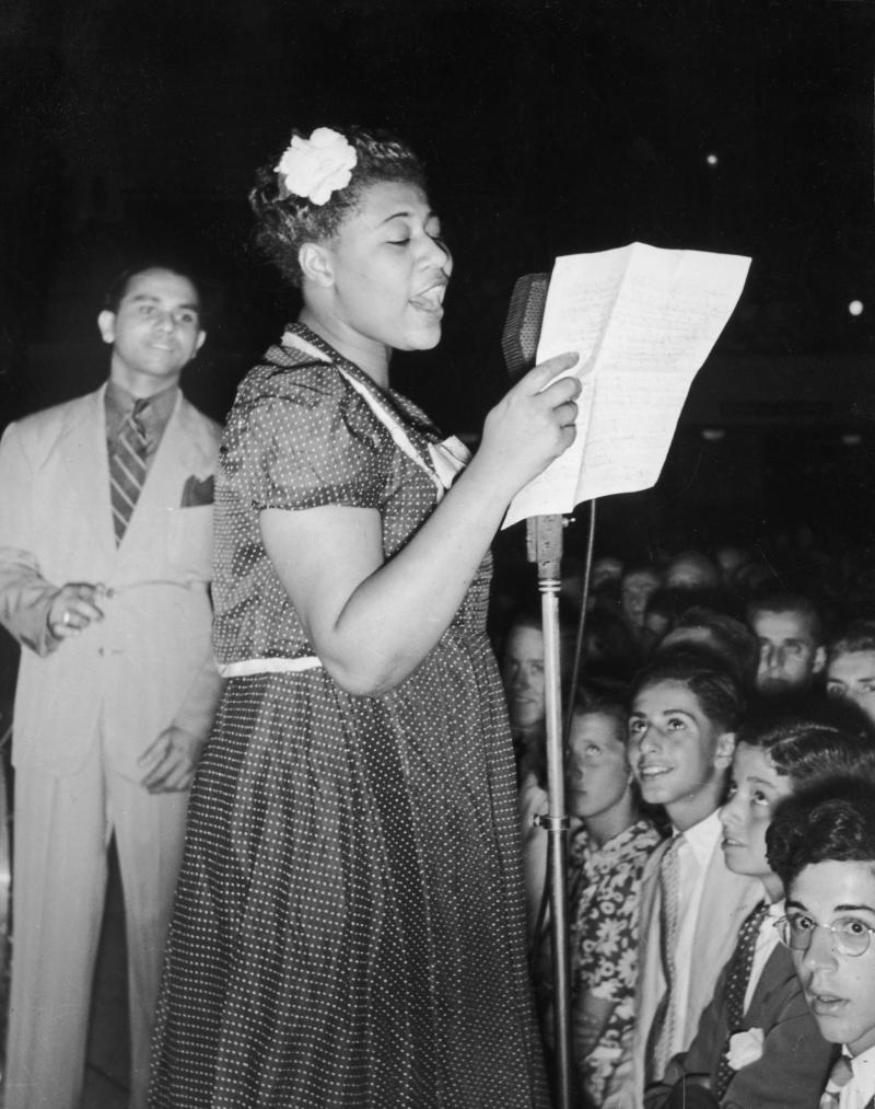 Ella Fitzgerald sings with bandleader Chick Webb in Asbury Park, N.J., in 1938.