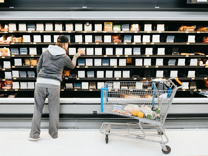 A person shops in front of the empty shelves in the deli section of a Walmart Supercenter in Nashville on Saturday.