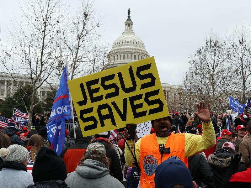 Protesters gather outside the U.S. Capitol on Jan. 6 in Washington, D.C., some with signs and symbols of Christianity. Pro-Trump protesters entered the U.S. Capitol that day after mass demonstrations in the nation's capital.