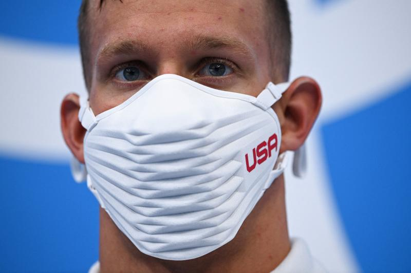 Team USA's Caeleb Dressel wears a USA-branded face covering while waiting to receive his gold medal after the final of the men's 4x100 meter freestyle relay swimming event during the Tokyo Olympics at the Tokyo Aquatics Centre on Monday.