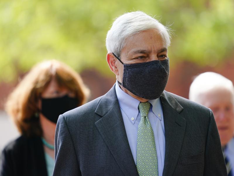 Former Penn State President Graham Spanier walks from the Dauphin County Courthouse in Harrisburg, Pa., after a hearing on Wednesday. A judge said Spanier must report to jail on July 9 to begin serving at least two months for endangering the welfare of ch