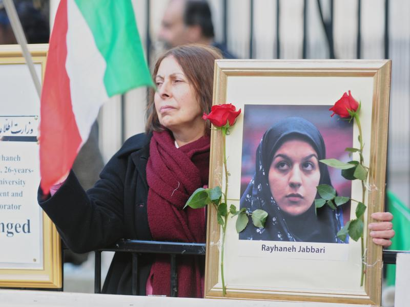 "People gather opposite Downing Street during a protest against the execution of a young woman in Iran, in October of last year. Amnesty International says that Iran has undergone an ""unprecedented spike"" in executions in recent months."