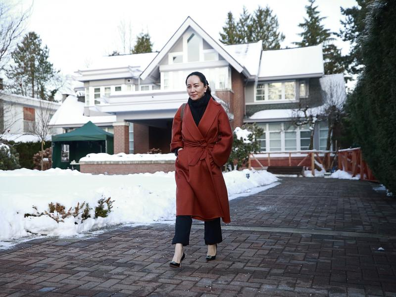 Huawei Chief Financial Officer Meng Wanzhou leaves her house on her way to a court appearance on Friday in Vancouver, Canada. The U.S. government has accused Meng of fraud.