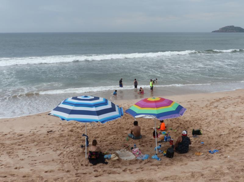 Beachgoers enjoy the shore in Mazatlan, Sinaloa state, Mexico on Sunday. Hurricane Willa, now a Category 5, is expected to land in the region late Tuesday or Wednesday.