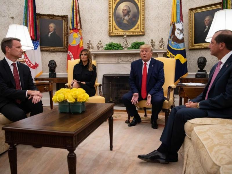 President Trump speaks to the press with first lady Melania Trump and Acting Food and Drug Administration Commissioner Norman Sharpless (left) and Health and Human Services Secretary Alex Azar in the Oval Office at the White House on Wednesday.