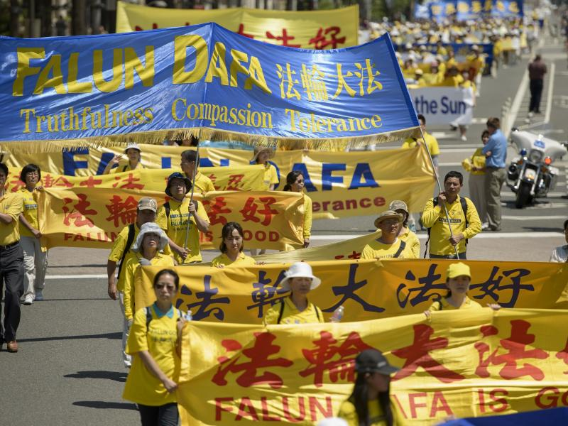 Falun Gong supporters marched from Capitol Hill to the Washington Monument in July 2015 in Washington, D.C.