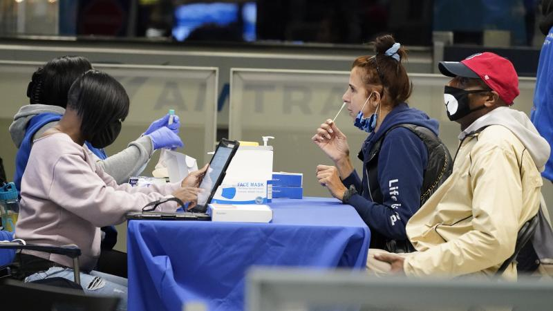 Travelers self-test for the coronavirus at a mobile testing site at New York City's Penn Station in the days leading up to Thanksgiving. The U.S. is currently seeing record hospitalizations for COVID-19, and health experts fear more surges are on their wa