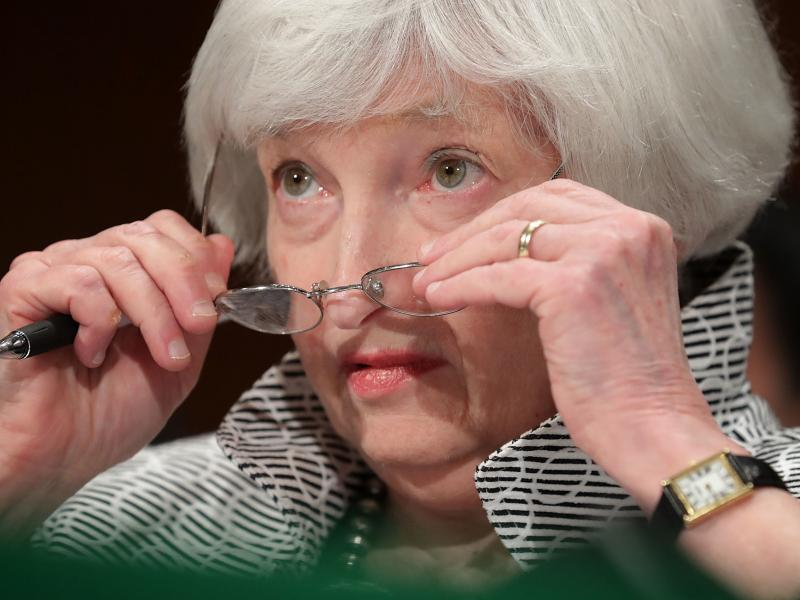Traders dial back rate hike view on Yellen's silence on policy