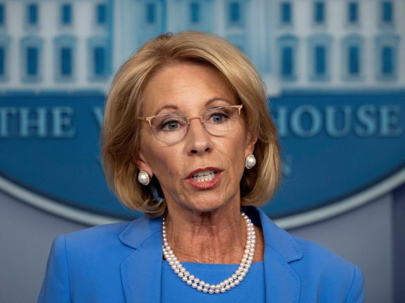 Secretary of Education Betsy Devos, seen on March 27, has released new rules for sexual assault complaints on college campuses.