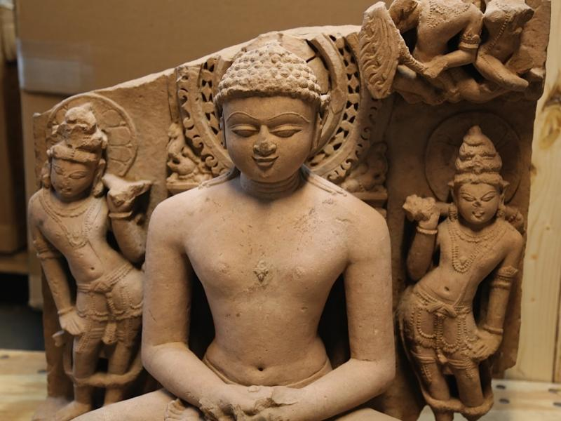 A sandstone statue of Rishabhanata, from Rajasthan or Madhya Pradesh, India, in the 10th century A.D., flanked by a pair of attendants. It is valued at approximately $150,000.