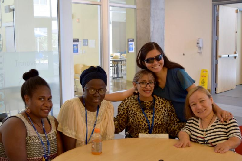 Disability activists from around the world attended a seminar in Oregon. From left, Joyce Peter of Vanuatu, Sidonie Nduwimana of Burundi,, Wendy Beatriz Caishpal Jaco of El Salvador, Gina Rose Balanlay of the Philippines (standing) and Raluca Oancea of Ro