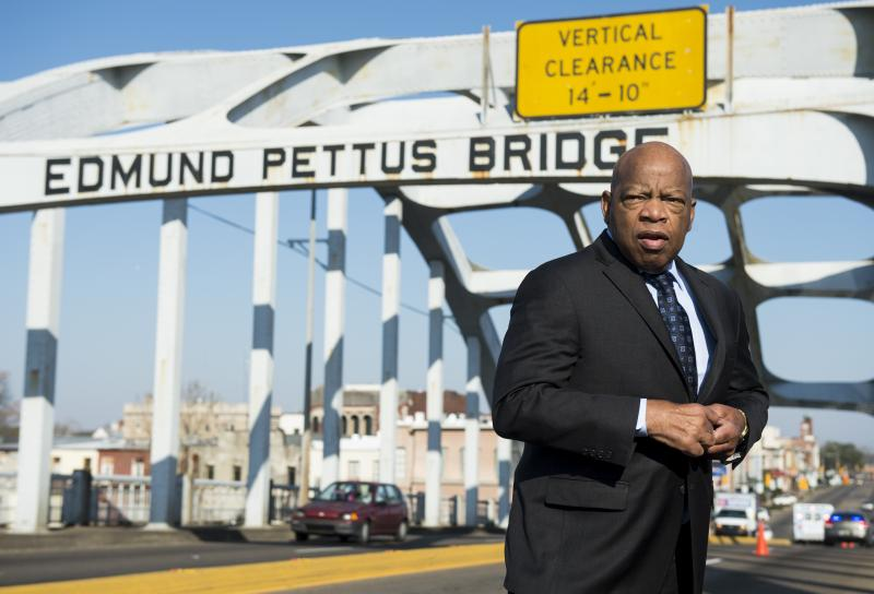 """The late Rep. John Lewis stands on the Edmund Pettus Bridge in Selma, Ala., in 2015, where he was beaten by police on """"Bloody Sunday."""""""