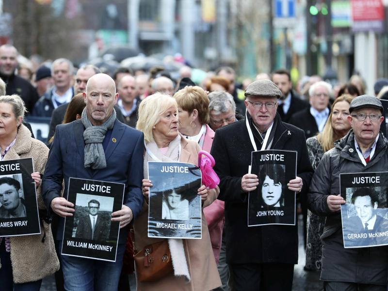 Families of victims of Bloody Sunday, in which 13 unarmed protesters were killed in 1972, marched before the prosecutor's announced charges against a former British paratrooper.