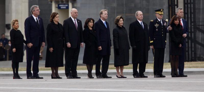 Former President George W. Bush (far right) and his wife, Laura Bush (second from right)
