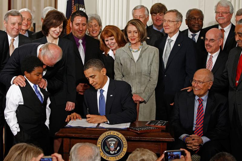 Rep. John Dingell was seated next to President Barack Obama when he signed the Affordable Care Act into law at the White House on March 23, 2010.