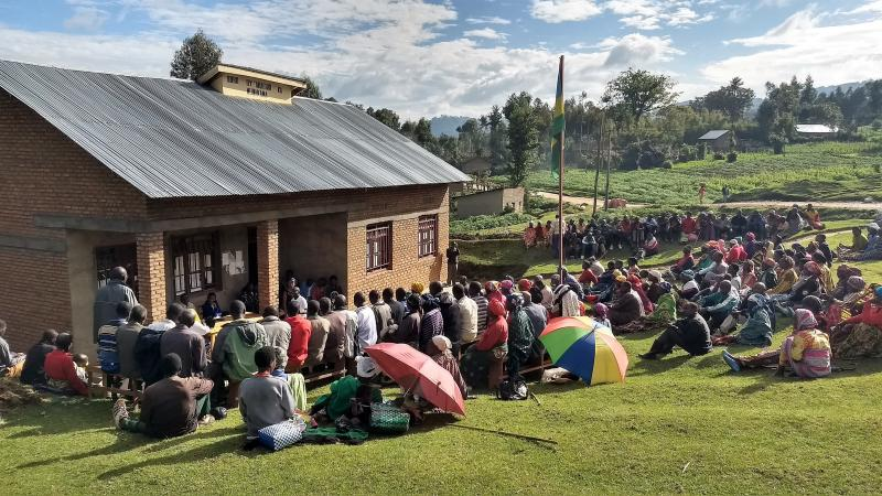 The Feed the Future Tworore Inkoko, Twunguke project hosts a meeting in the Gataraga sector of Rwanda to recruit farmers to grow chickens. If the farmers commit to four days of training and pass a competency test, they are given a backyard coop worth abou