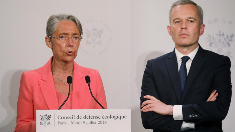 """French Transport Minister Elisabeth Borne says a new tax on airfares """"is a response to the ecological urgency and sense of injustice expressed by the French."""" She's seen here with Minister for the Ecological and Inclusive Transition Francois de Rugy."""