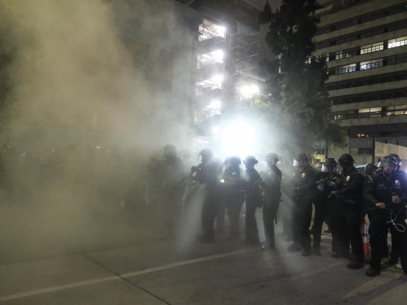 Police officers fire rubber bullets May 29 during a Los Angeles protest over the death of George Floyd.