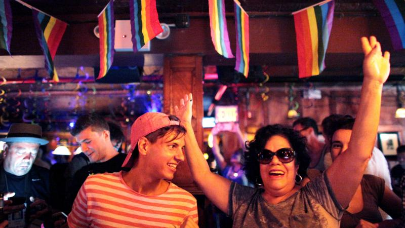 People celebrate inside the Stonewall Inn, an iconic gay bar recently granted historic landmark status, after the U.S. Supreme Court ruled same-sex couples have the right to marry in all 50 states.