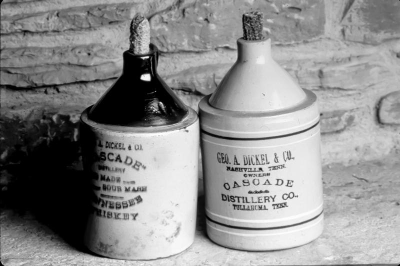 Before distilleries used glass bottles, many of them offered liquor stores branded ceramic jugs that could be filled and sold to customers. This pair of George Dickel jugs was used around 1900. From The Art of American Whiskey by Noah Rothbaum.