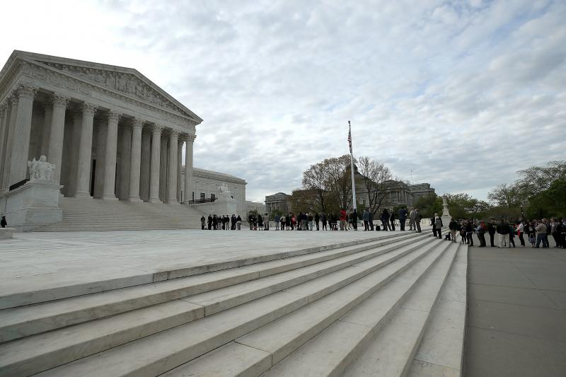 People wait in line to enter the U.S. Supreme Court, on April 23, 2018. There's less than a month left in the Court's term and many of the most controversial and contentious cases will be decided in the coming weeks.