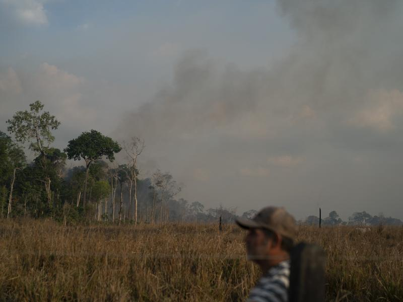 Moacir Cordeiro, who works in a local cattle farm, looks on after digging grooves with a tractor in an attempt to stave off fires in the Alvorada da Amazonia region in Novo Progresso, Para state, Brazil, on Sunday.
