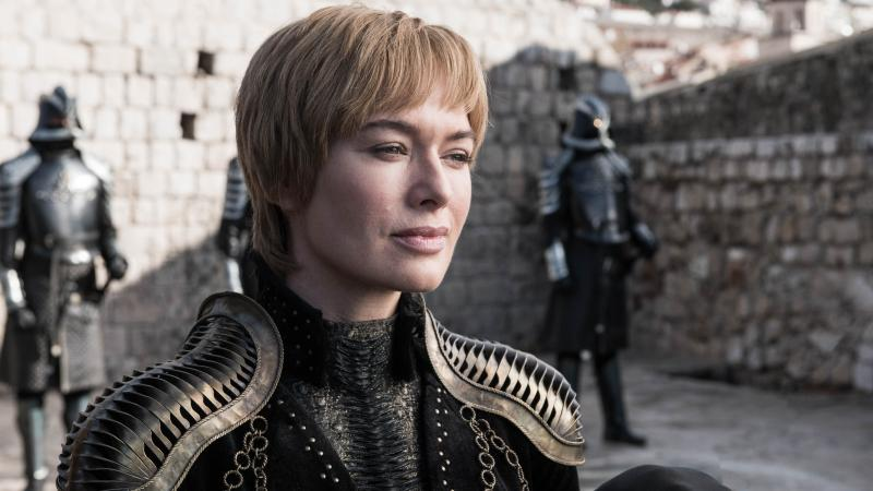 Queen Cersei (Lena Headey) smiling that smile of hers on Game of Thrones. Shoulder pads courtesy of Julia Sugarbaker.