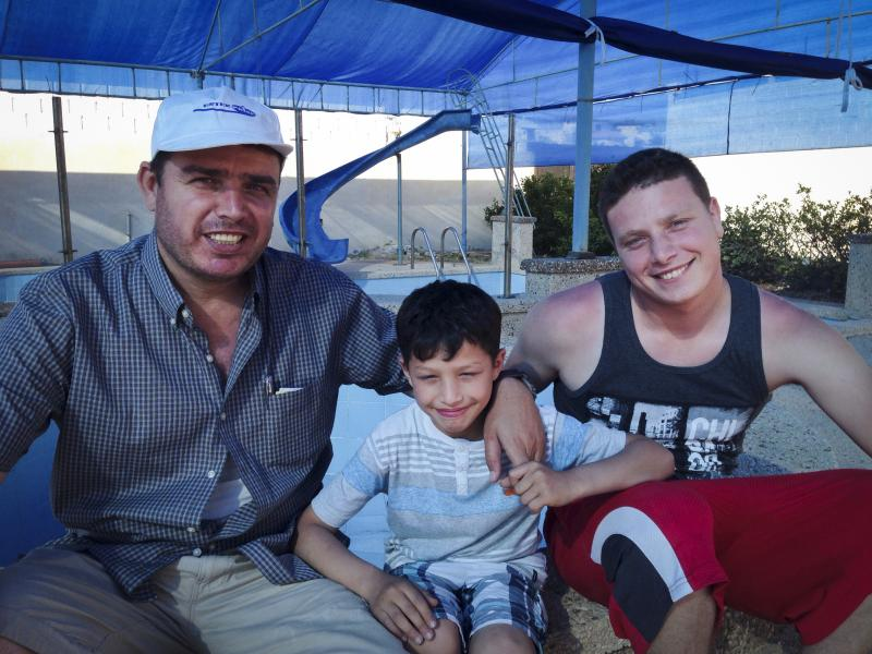 Ihab al-Aloul (left) and his sons Abdel Rahman, 9, and Ahmed, 22, at the family's pool in Gaza City. The Aloul family left Gaza in 2008 and moved to British Columbia, Canada, but returned to Gaza in the fall of 2014.