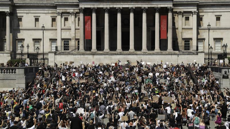 Hundreds demonstrated in Trafalgar Square in central London on Sunday, and many kneeled, to protest the recent killing of George Floyd by police officers in Minneapolis.