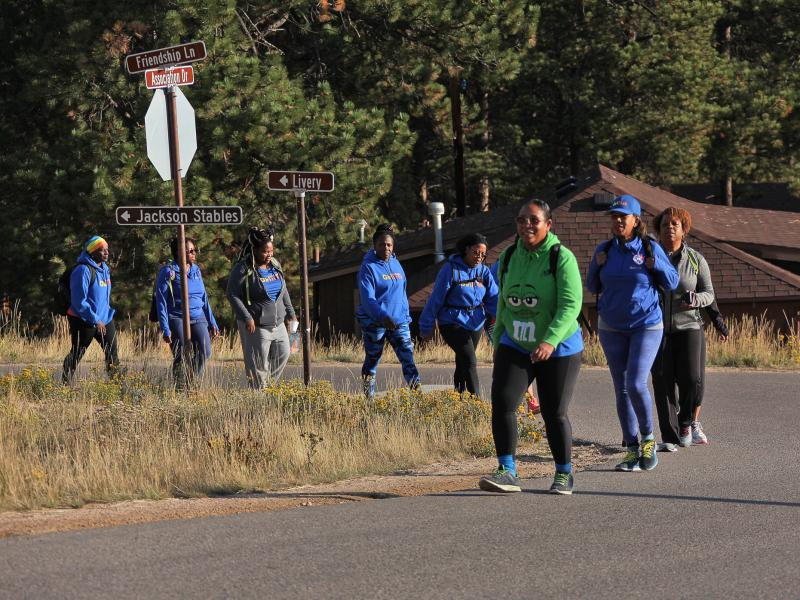 In 2018, GirlTrek members gathered for a weekend retreat in Rocky Mountain National Park as part of their #StressProtest.
