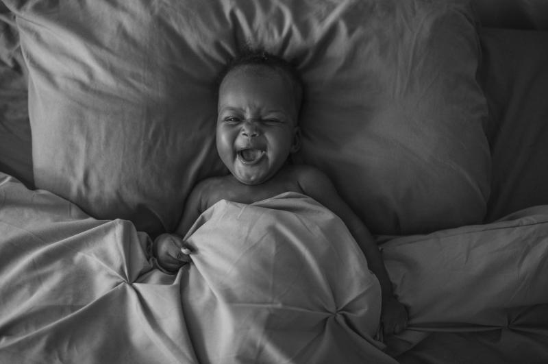 """Photographer Sarah Waiswa's image of her daughter, Ria:  """"She spends a lot of time in our bed. Babies bring the hope of goodness and light, but 2020 has been a heavy year. I am afraid about the type of world I have brought her into. I hope by the time Ria"""