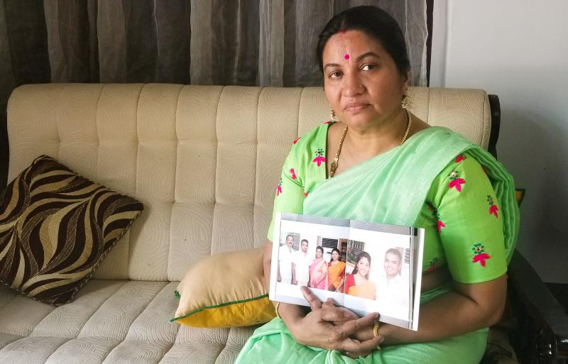 Bindu Sampath, 52, shows photos of her daughter Nimisha Sampath, now 29, who left India three years ago, after converting to Islam. She and her husband, a fellow Muslim convert, are wanted by Indian authorities for allegedly joining ISIS. They're believed