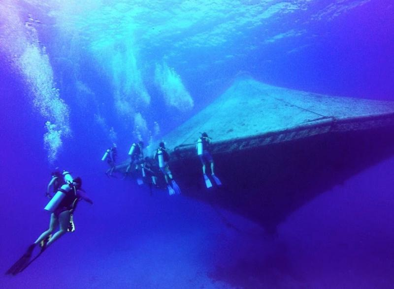 Divers around the open-ocean aquaculture cage at the Cape Eleuthera Institute in the Bahamas. These cages are not currently used in the Gulf of Mexico, but represent one type of farming technology that could work in the region.
