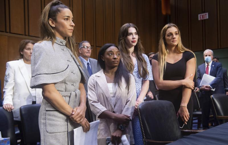 Gymnasts (from left) Aly Raisman, Simone Biles, McKayla Maroney and Maggie Nichols leave after testifying Wednesday at a Senate Judiciary Committee hearing on the FBI's handling of the Larry Nassar investigation. Nassar was charged in 2016 with federal ch