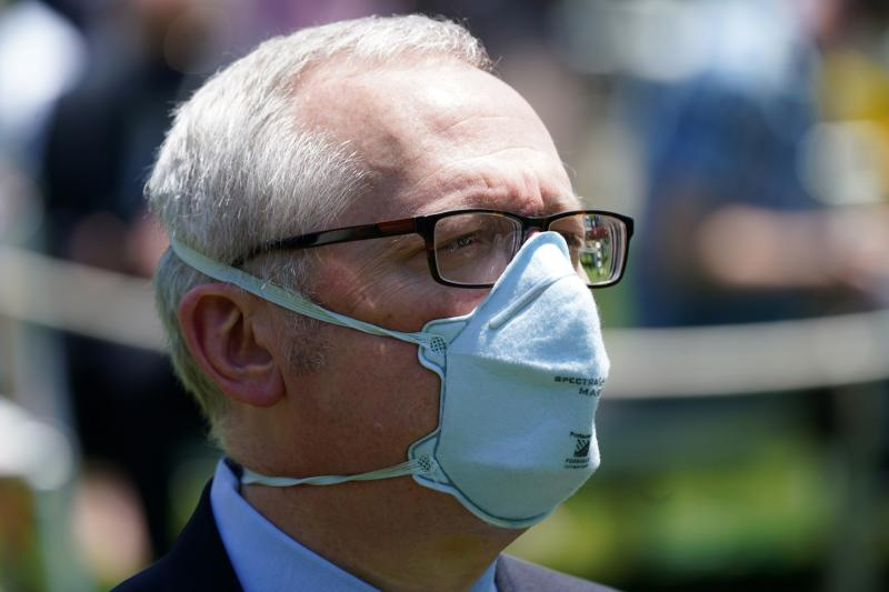 Michael Caputo, pictured at a White House event, is taking a 60-day leave of absence from his job as lead spokesperson for the Department of Health and Human Services after alleging President Trump's opponents have interfered in the coronavirus response.