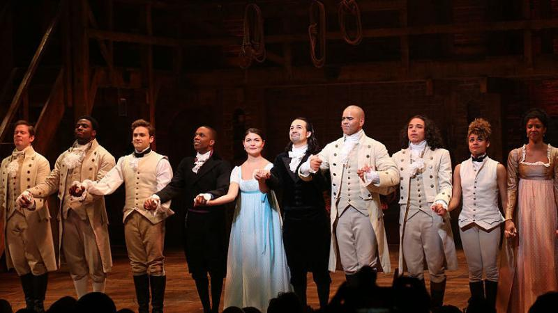 "Leslie Odom Jr., Phillipa Soo and Ariana DeBose with Lin-Manuel Miranda with the cast during their final performance curtain call of ""Hamilton"" in July."