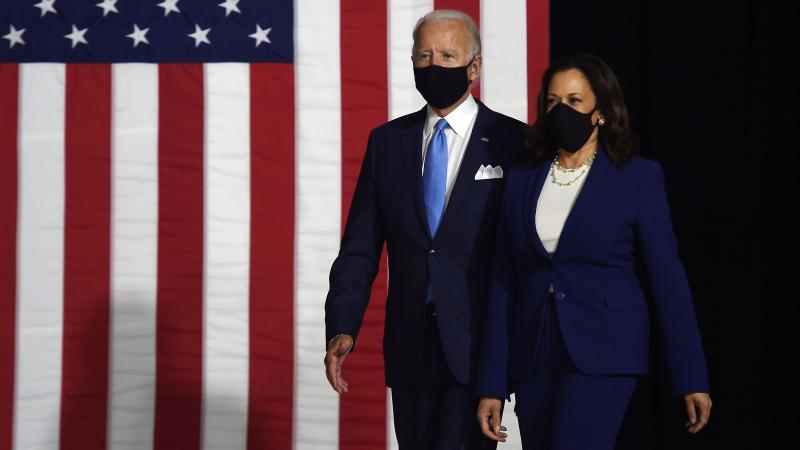 Presumptive Democratic presidential nominee Joe Biden and his vice presidential running mate, Sen. Kamala Harris, arrive to conduct their first appearance together in Wilmington, Del., on Wednesday.