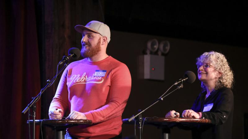 Contestants Christian Thomsen and Nancy Libow face off in a game on Ask Me Another at the Bell House in Brooklyn, New York.