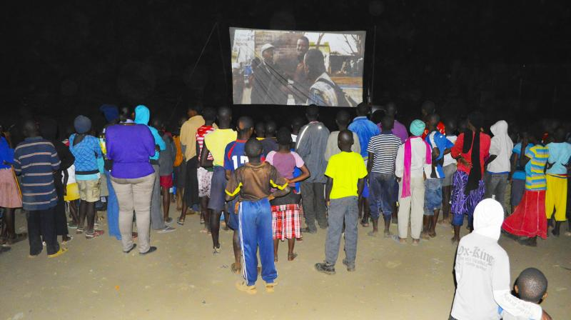 Movie lovers in Nairobi gather for a nighttime screening at last year's Slum Film Festival.