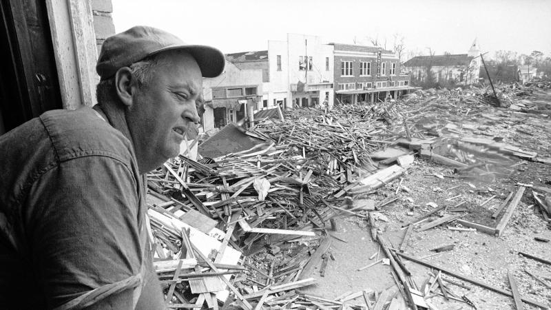 Parnell McKay, the civil defense director of Pass Christian, Miss., looks over the town's main business district on Aug. 23, 1969 after Hurricane Camille passed through.